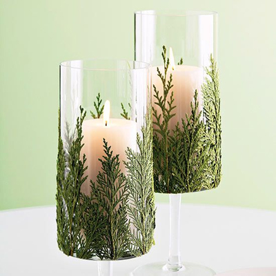 Christmas greenery in glass for decorating fireplace mantel