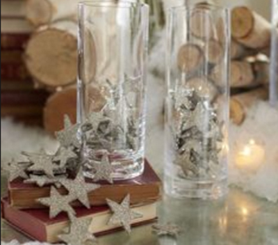 Decorate a fireplace mantel for Christmas with  star tinsel