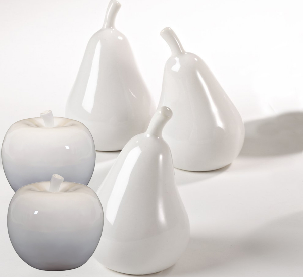 White ceramic fruit including apples and pears are a more formal look than fresh fruit.