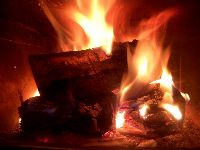 Hot roaring fire in the fireplace
