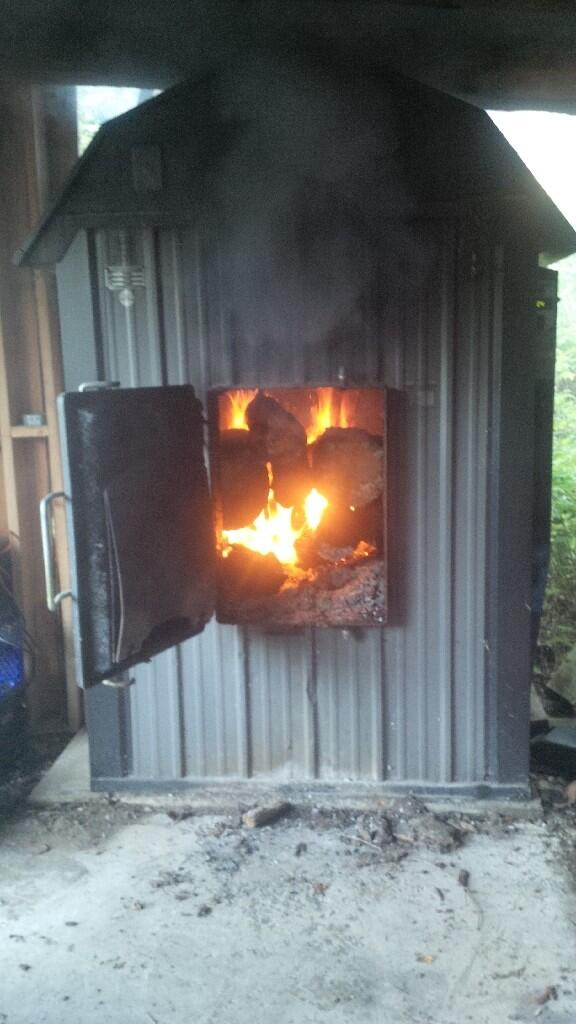 First Fire of the Season in a Wood-Burning Furnace.