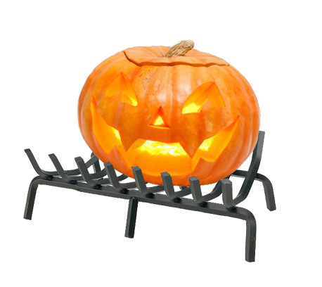 Jack o'lantern with lit candle on fireplace grate.
