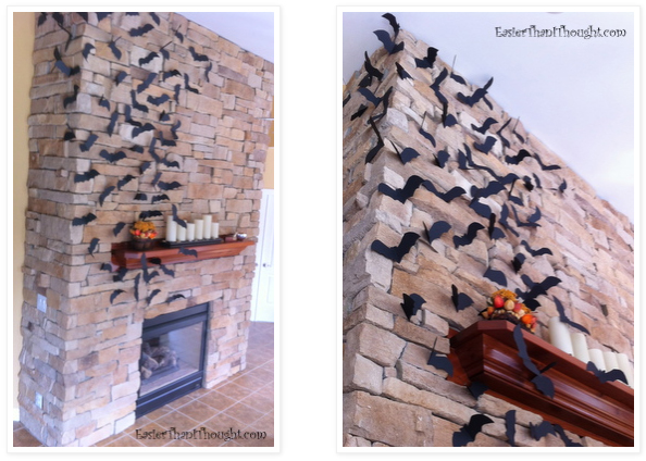 Cut bat shapes from black cardstock, fold wings, and attach to fireplace with sticky tack.