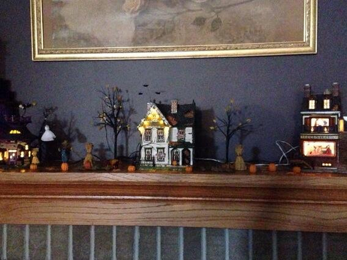 Halloween houses on the fireplace mantel.