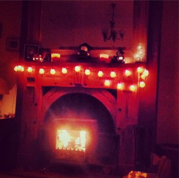 Pumpkin garland lights accent the Halloween mantel.