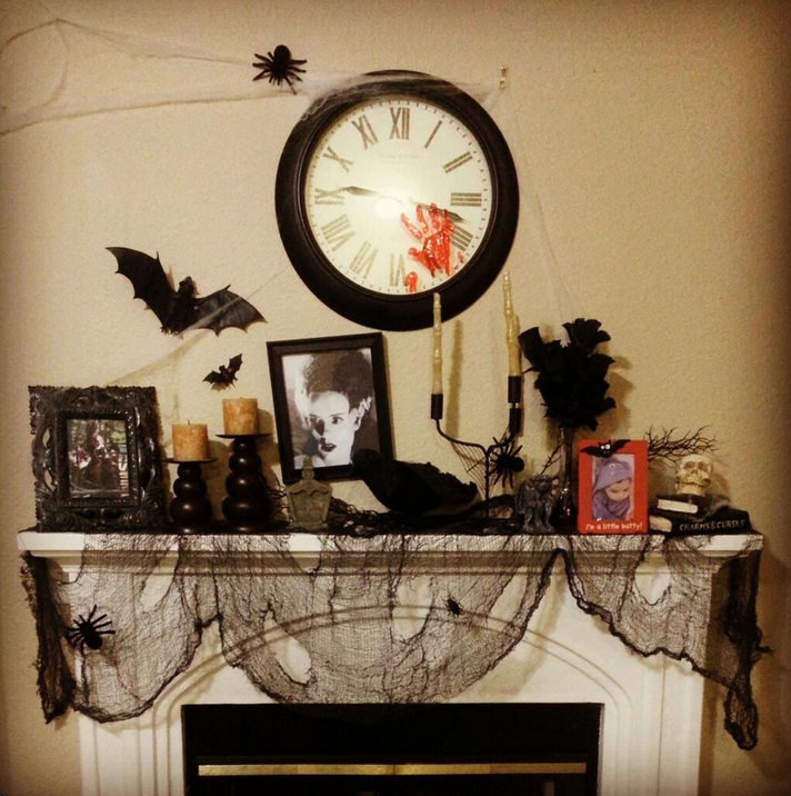 Don't miss the bloody hand print on the clock above this Halloween fireplace mantel!
