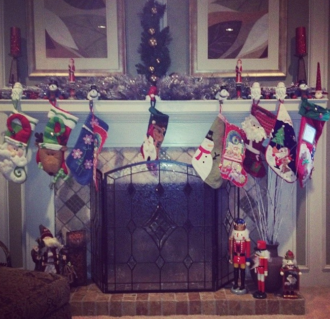 The grandkids' stockings all hang from the proud grandparent's fireplace mantel.