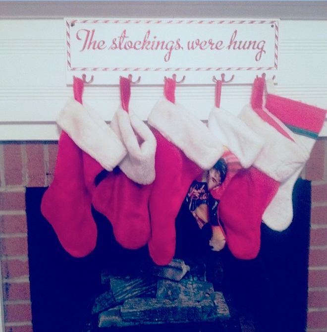 This plaque with its own hooks makes it simple to display the family stockings.