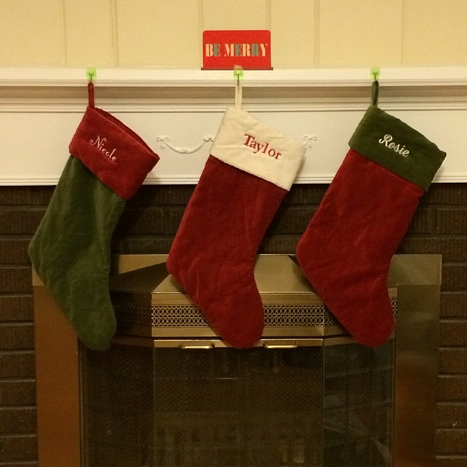 Cranberry and hunter green stockings are a classy take on traditional Christmas colors.