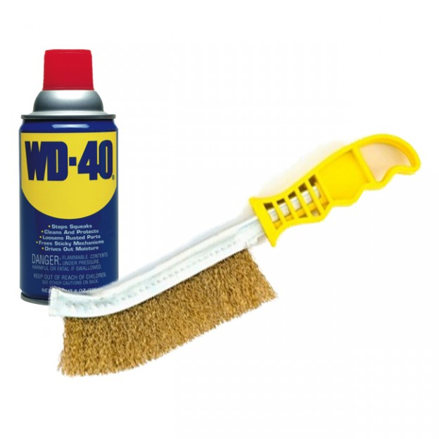 Use a wire brush and WD-40 to open a stuck fireplace damper.