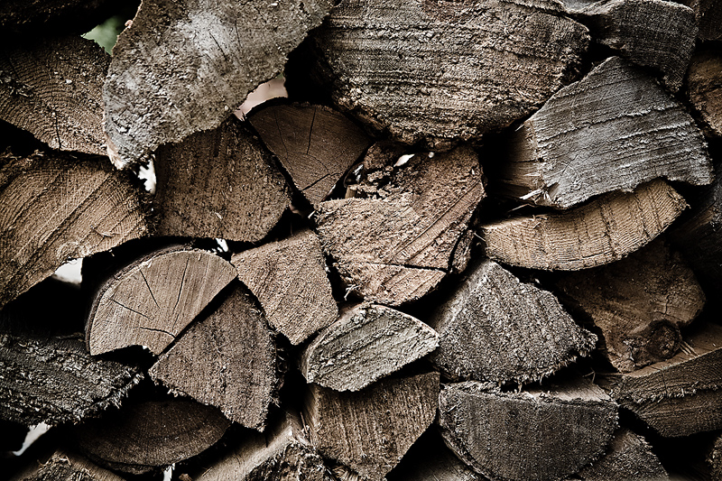 To build a fire, use dry, split hardwood that has seasoned at least 6 months.