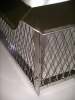 Chimney Cap flanges turned inside of mesh screen.