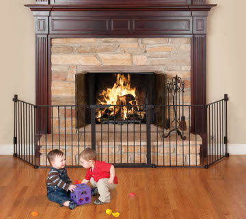 Child safety gate around fireplace