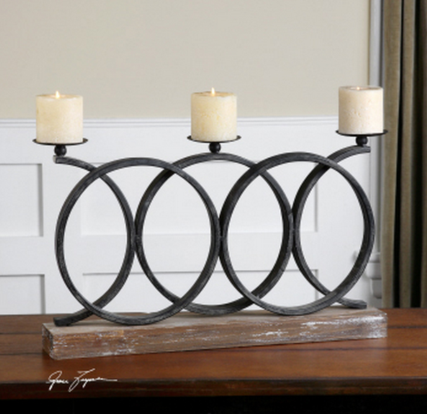The Kara Fireplace Candelabra is narrow enough to use on a fireplace mantel or a narrow table.