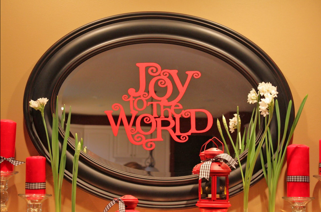 Vinyl Christmas decal on existing fireplace mirror.