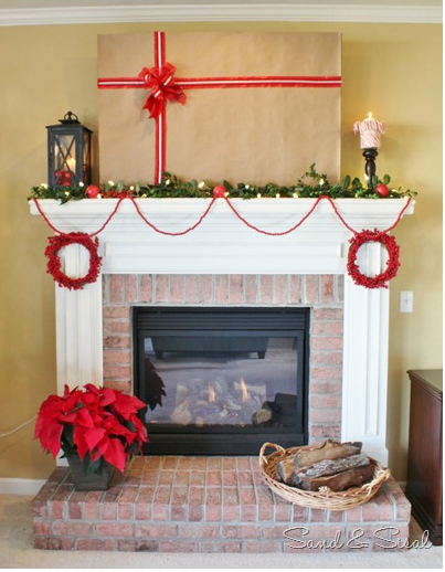 Hide fireplace TV for Christmas with a removable Christmas wrap.