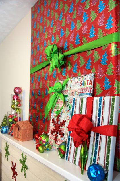 Hide TV for Christmas with gift wrap and bow.