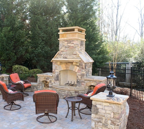 Stone Chimney Topper on Outdoor Chimney