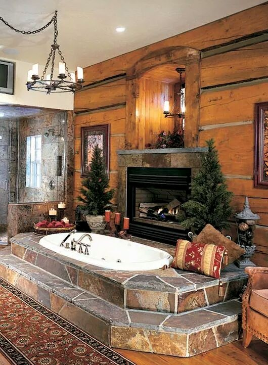 Stones surround the oval tub with a view of the store fireplace and wood plank walls.