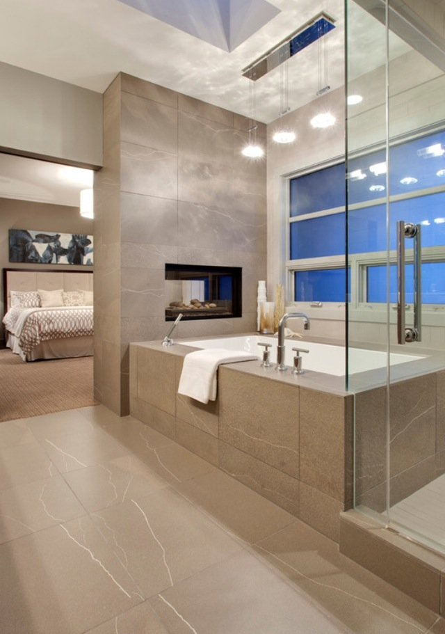 Fireplace separates bedroom and bath