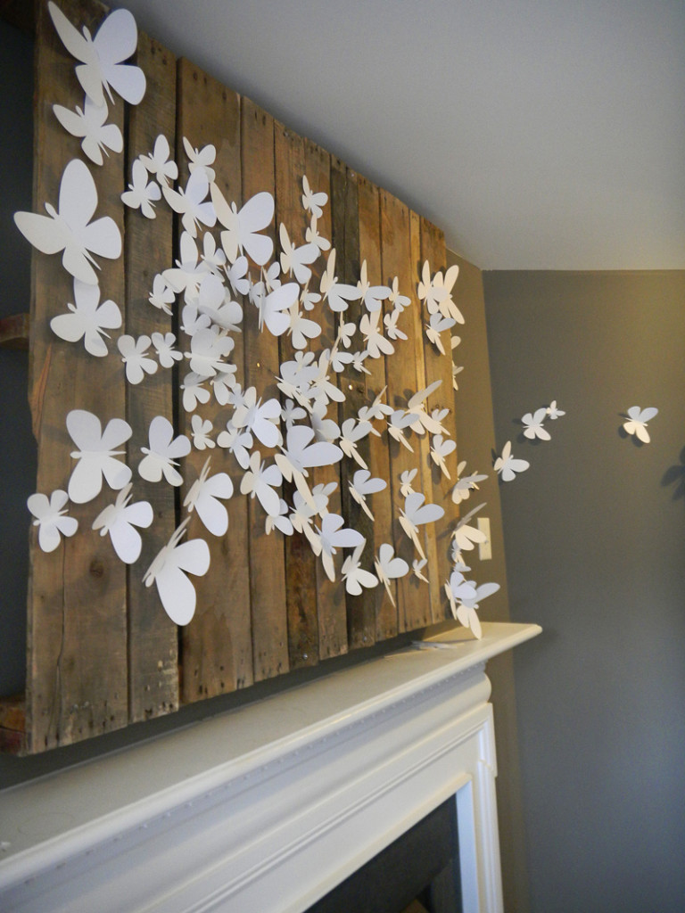 3D butterflies above fireplace are an inexpensive way to decorate