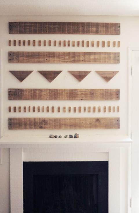 Scrap wood art display above fireplace