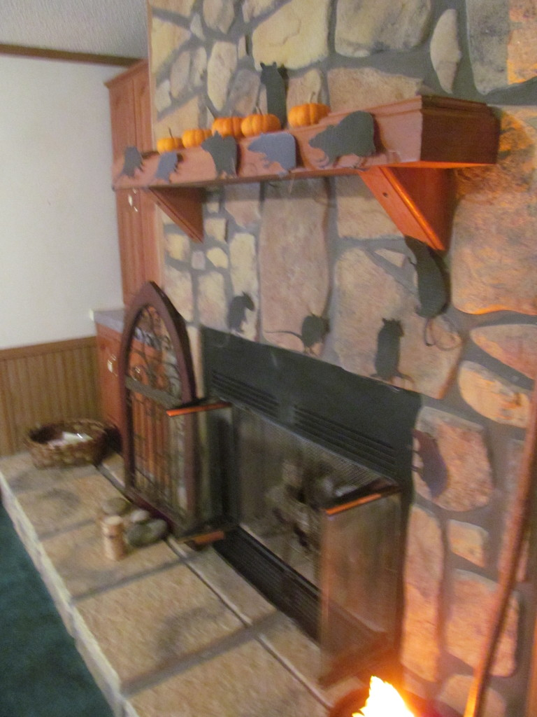 Add Halloween pumpkins, spider webs, witch's cauldron or witch's broom to the mantel and hearth.